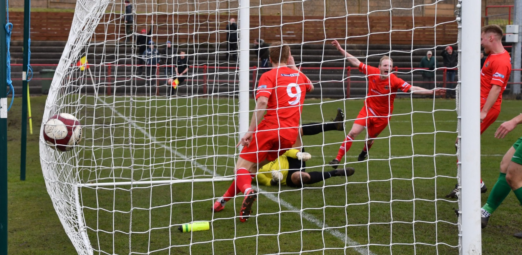 Dav-Symingtons-extraordinary-free-kick-hits-home-for-Workington-Reds-Ben-Challis-scaled